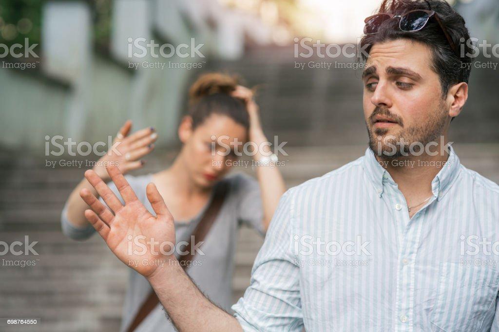 Male turning back with irritation stock photo