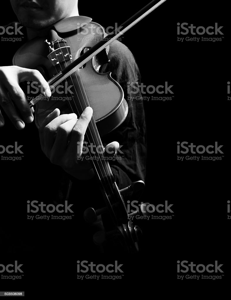 male violinist hands playing classical violin, isolated on black stock photo