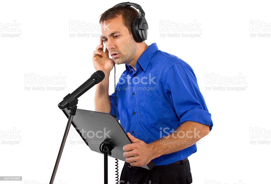 Male Voice Over Artist or Singer with a Microphone stock photo