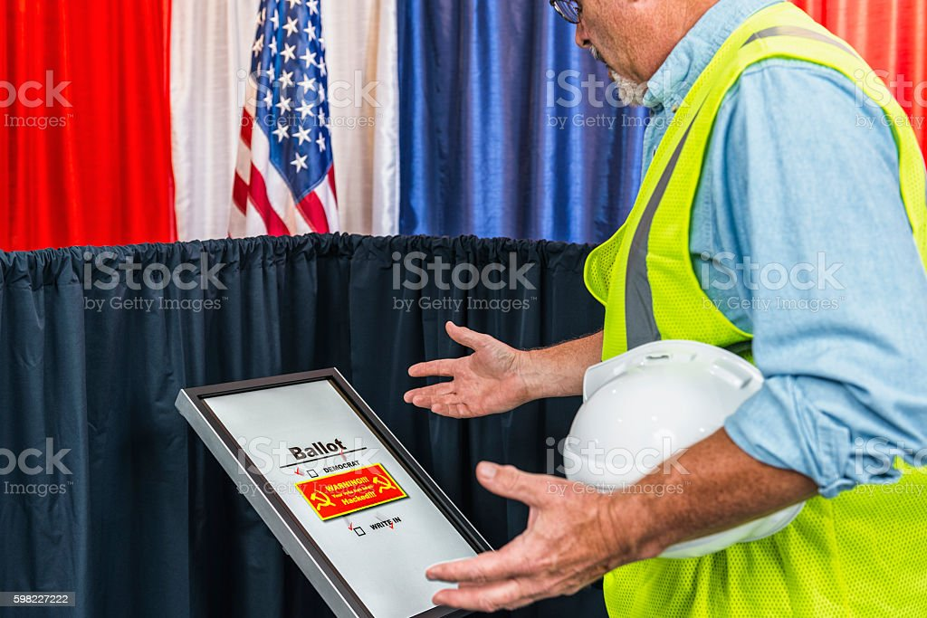 Male voter surprised that his vote was hacked by Russia stock photo