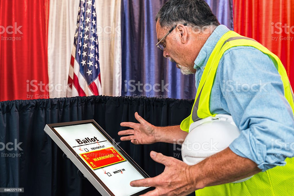 Male voter surprised that his vote was hacked stock photo