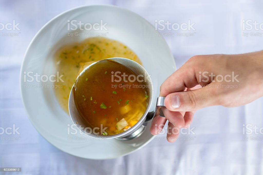 Male waiter serving soup stock photo