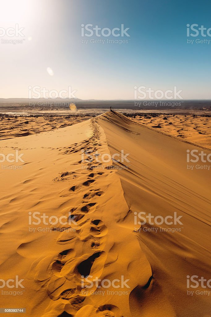 Male waiting , sand, dunes,waiting ,afternoon, Erg Chebbi, Morocco stock photo