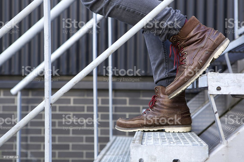 Male walking downstairs stock photo