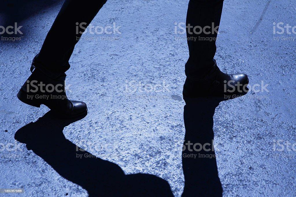 Male walking in blue night shadows stock photo