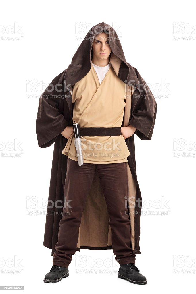 Male warrior with a brown hooded cape stock photo
