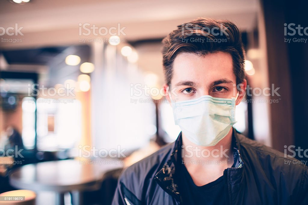 Male wearing face mask, protection from virus infection. stock photo