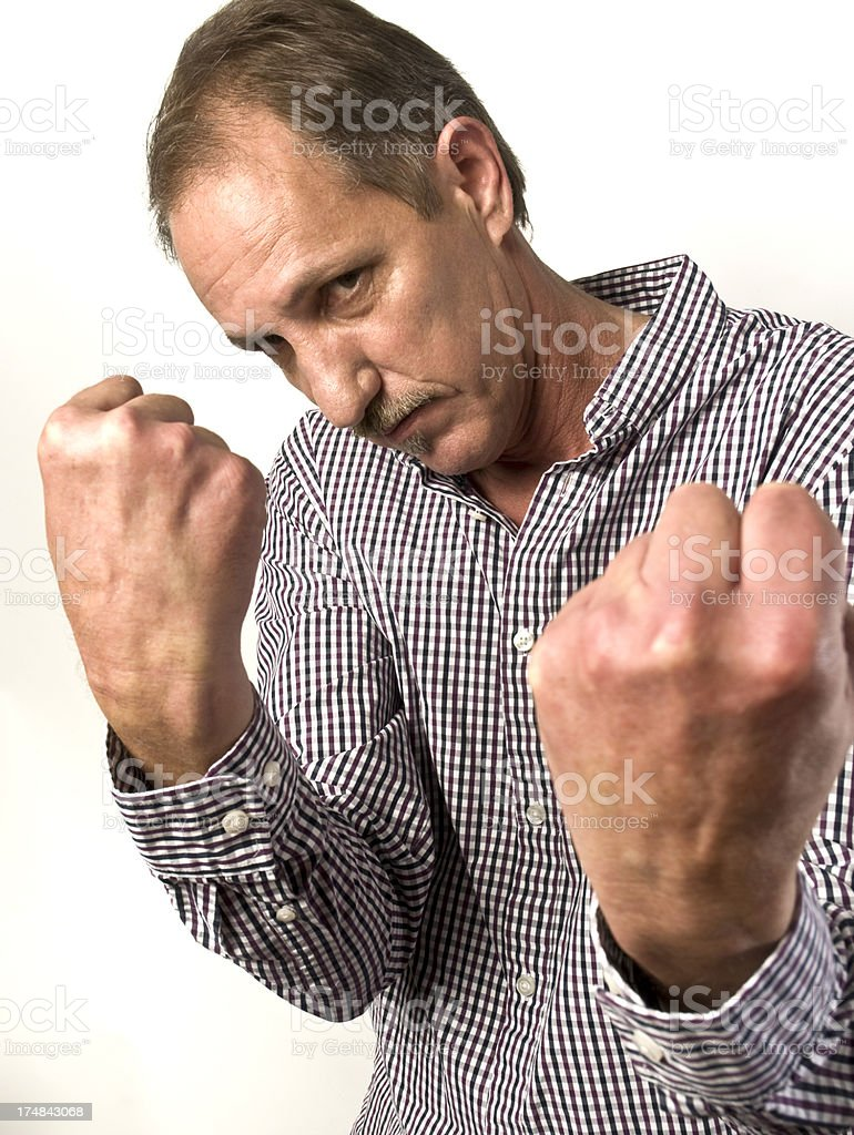 Male With Fists Wanting To Fight royalty-free stock photo