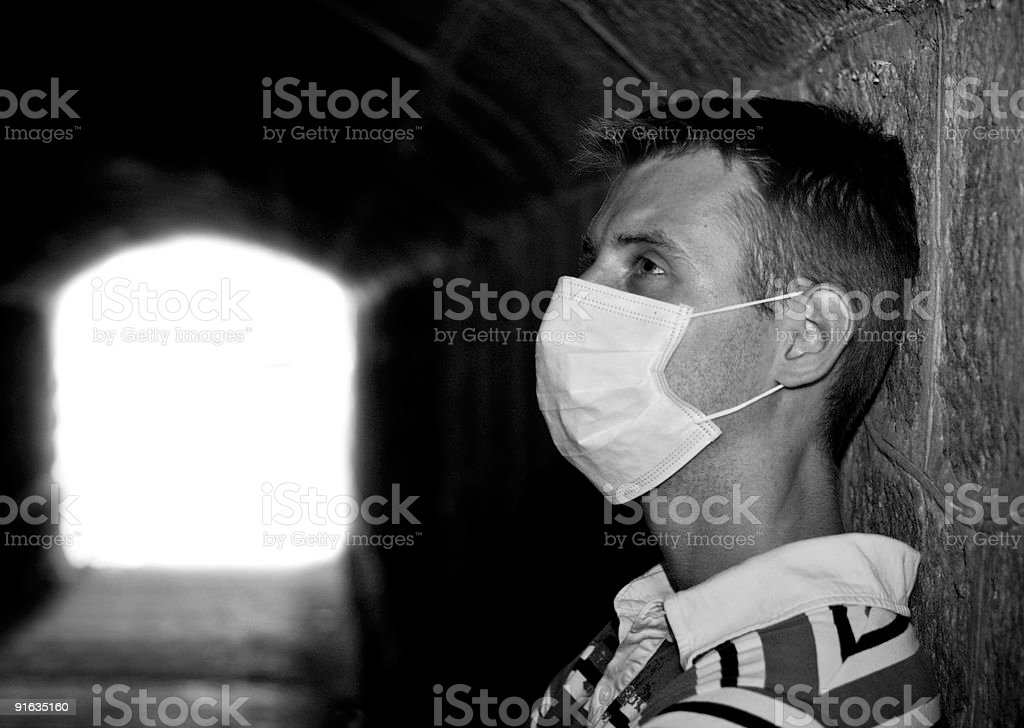 Male with Gauze bandage in dark tunnel royalty-free stock photo