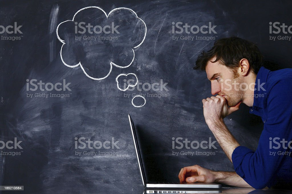 Male with laptop against blackboard royalty-free stock photo