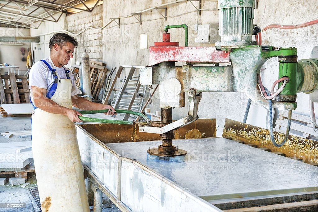 Male Worker on Marble or Granite Bevel stock photo