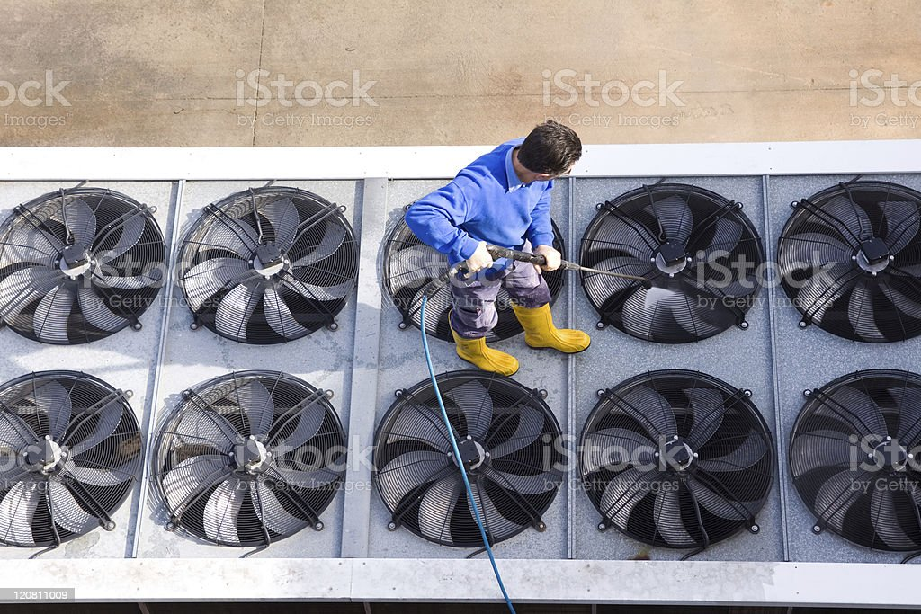 A male worker using a power washer stock photo