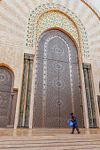 Male worker,main gate Hassan II Mosque, Casablanca, Morocco,