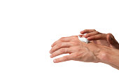 Male working hands put on a hands cream. Isolated