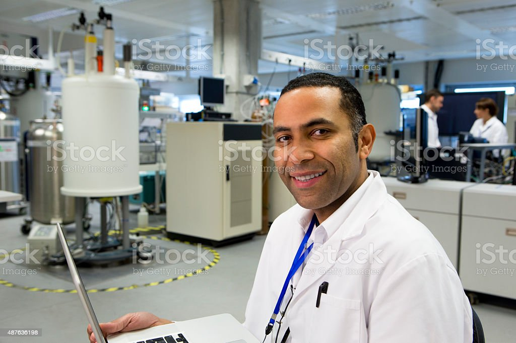 Male Working with Specialist Scientific Equipment stock photo