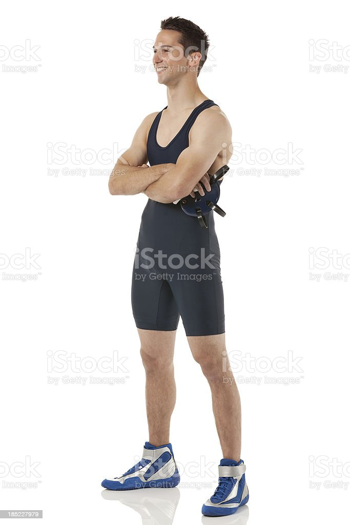 Male wrestler standing with his arms crossed stock photo
