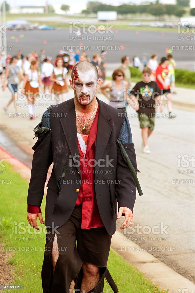 Male Zombie Rests After Chasing Humans In 5K Race stock photo