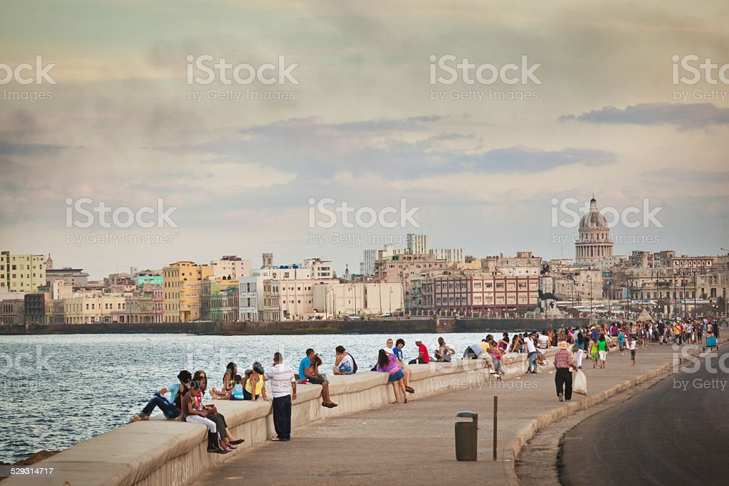 Malecón, Old Havana, Cuba, with People Relaxing on Seawall stock photo