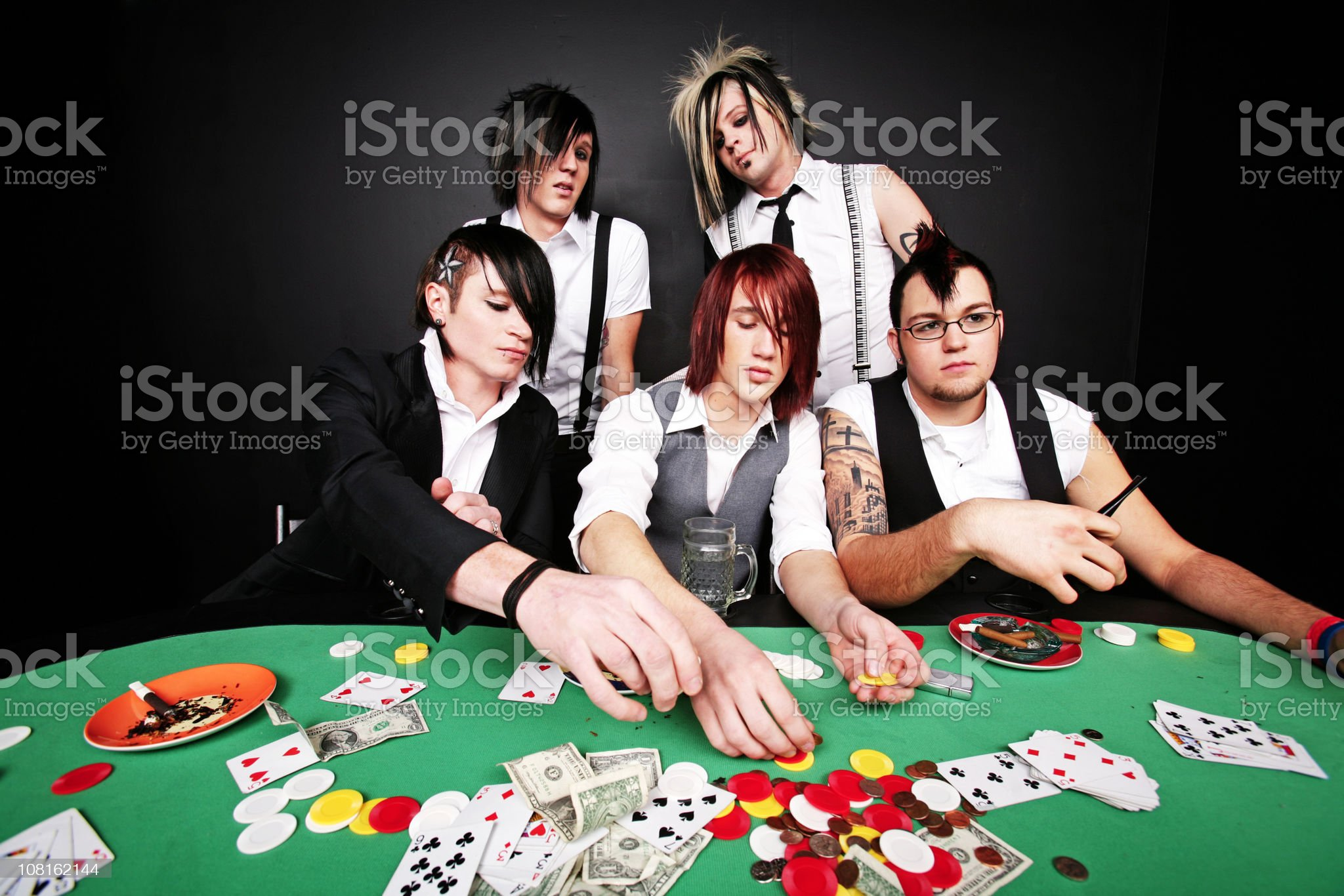 Males Passing Poker Chips at a Table royalty-free stock photo