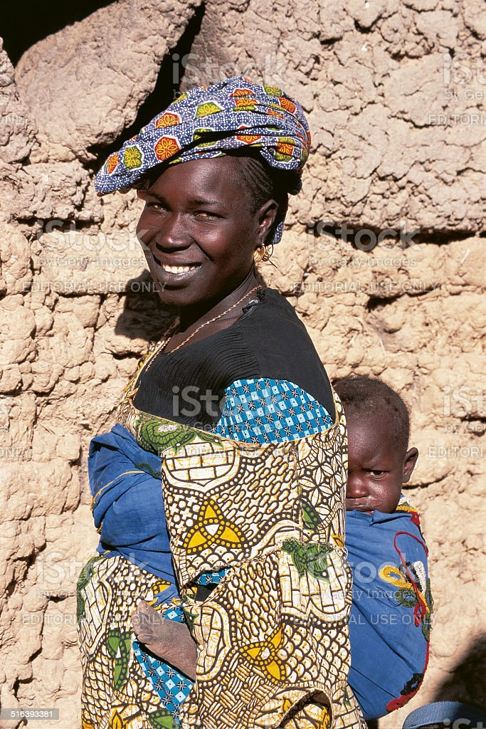 Malinese woman carries her child stock photo