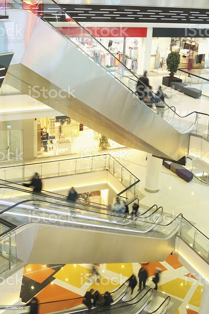 mall with escalators and people in motion royalty-free stock photo