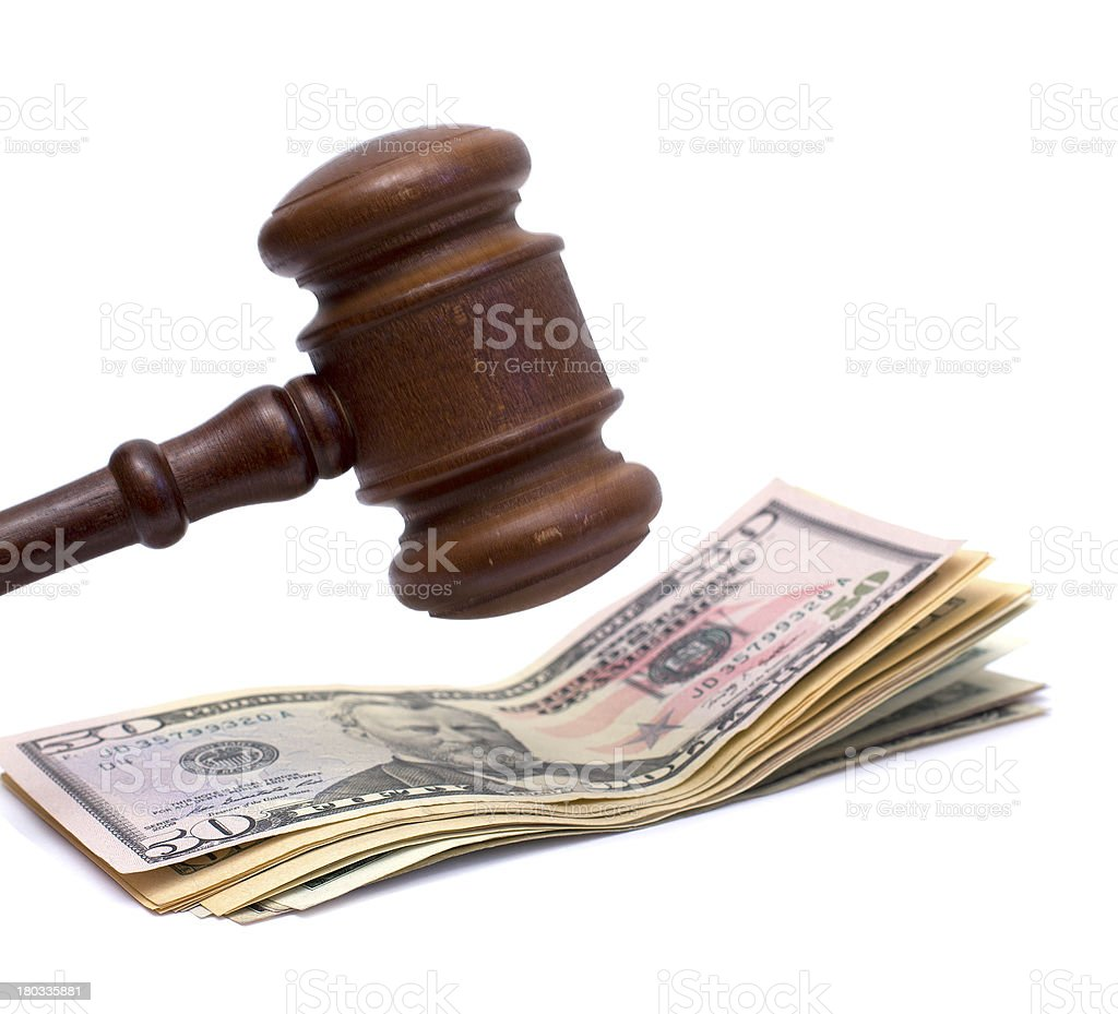A mallet about it hit bank notes stock photo