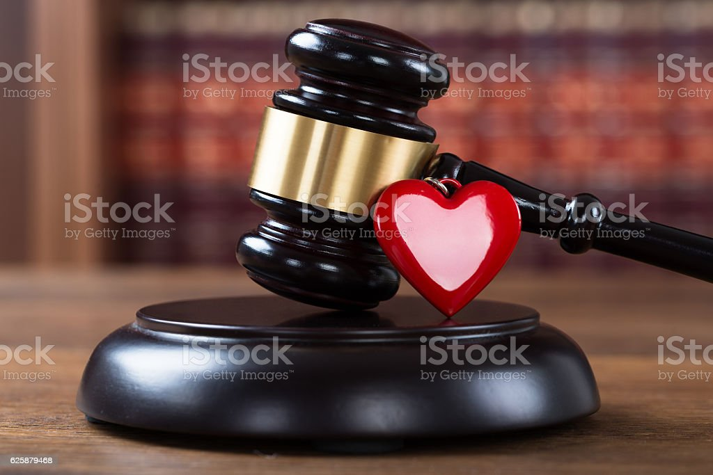 Mallet And Heart On Table In Courtroom stock photo