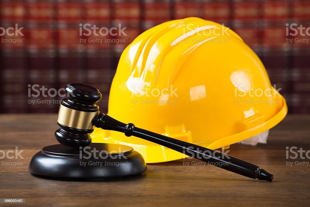 Mallet And Yellow Hardhat In Courtroom stock photo