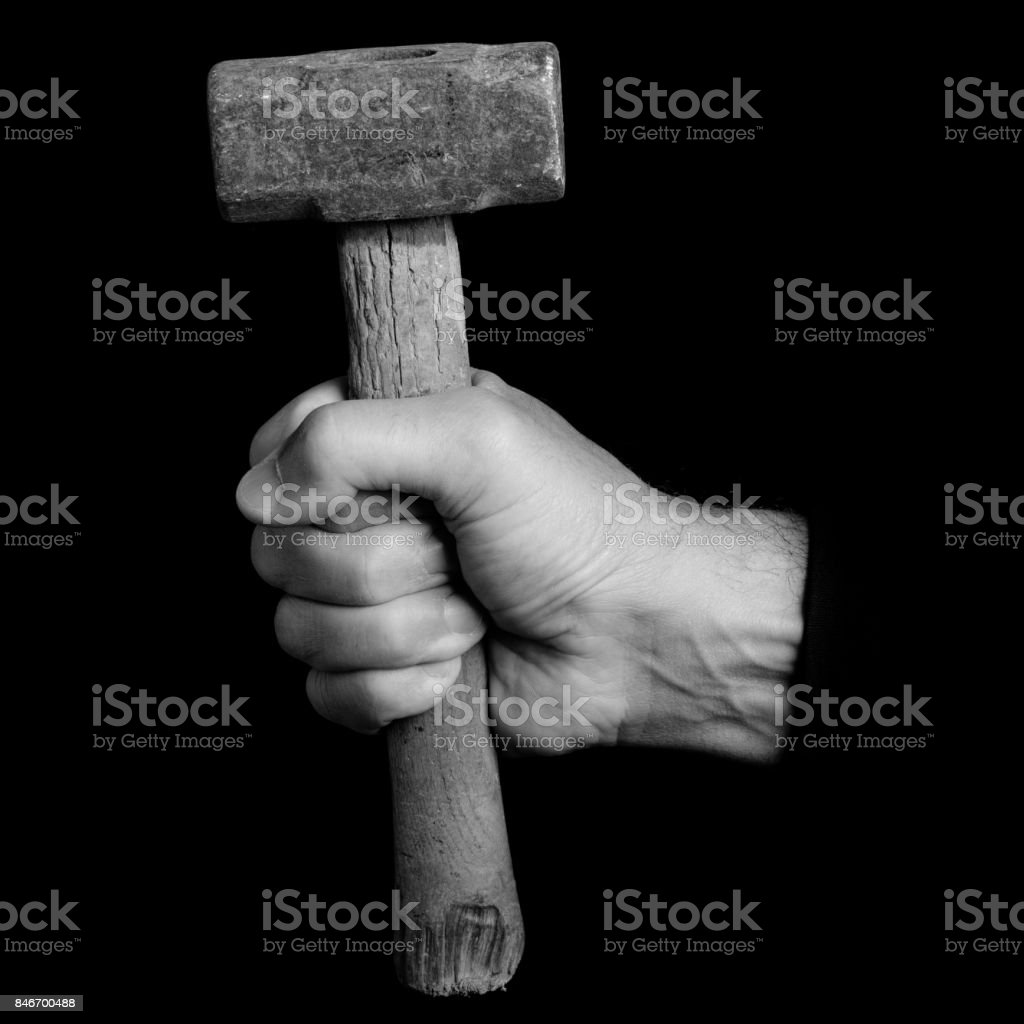 mallet - tools in a man's hand - black and white photo stock photo