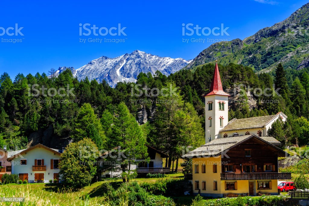 Maloja under blue sky in summer stock photo