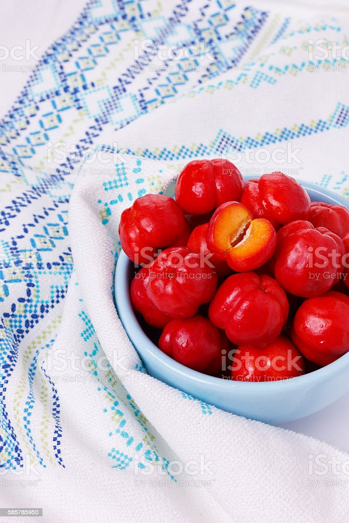 Malpighia glabra (red acerola), tropical fruit in bowl stock photo