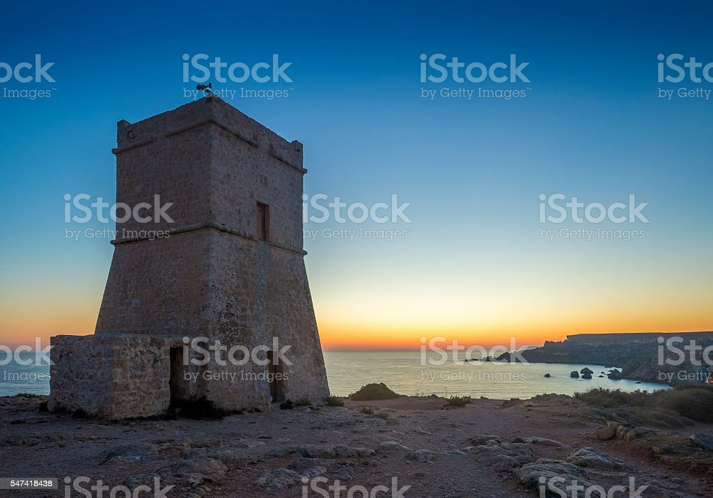 Malta, Ghajn Tuffieha Tower at sunset with clear blue sky stock photo
