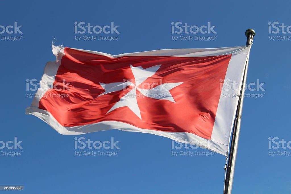 Maltese flag on sky stock photo