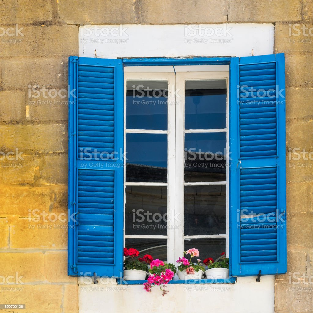 Maltese window decorated with flowers stock photo