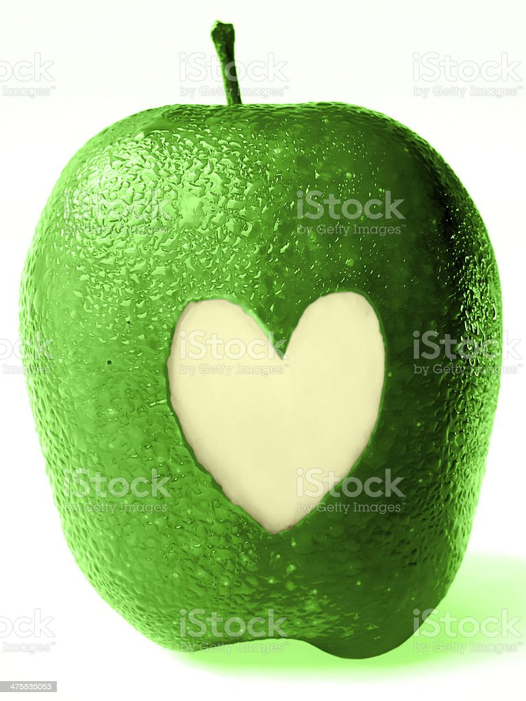 Malus pumila, Apple with heart shape carved on it stock photo