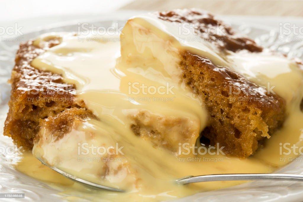 Malva pudding with custard stock photo