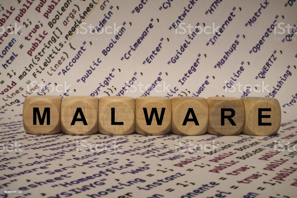 malware - cube with letters and words from the computer, software, internet categories, wooden cubes stock photo