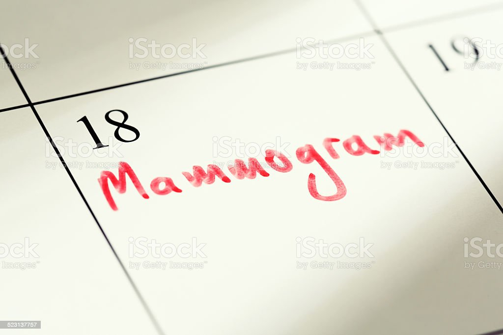 Mammogram appointment marked in red on calendar. Vital health check. stock photo