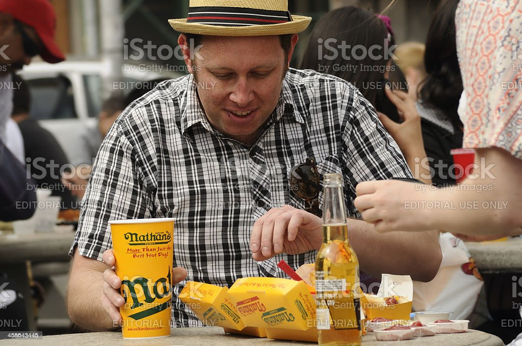 Man about to eat at Original Nathan's Famous Hot Dogs stock photo