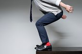 Man about to jump off a desk