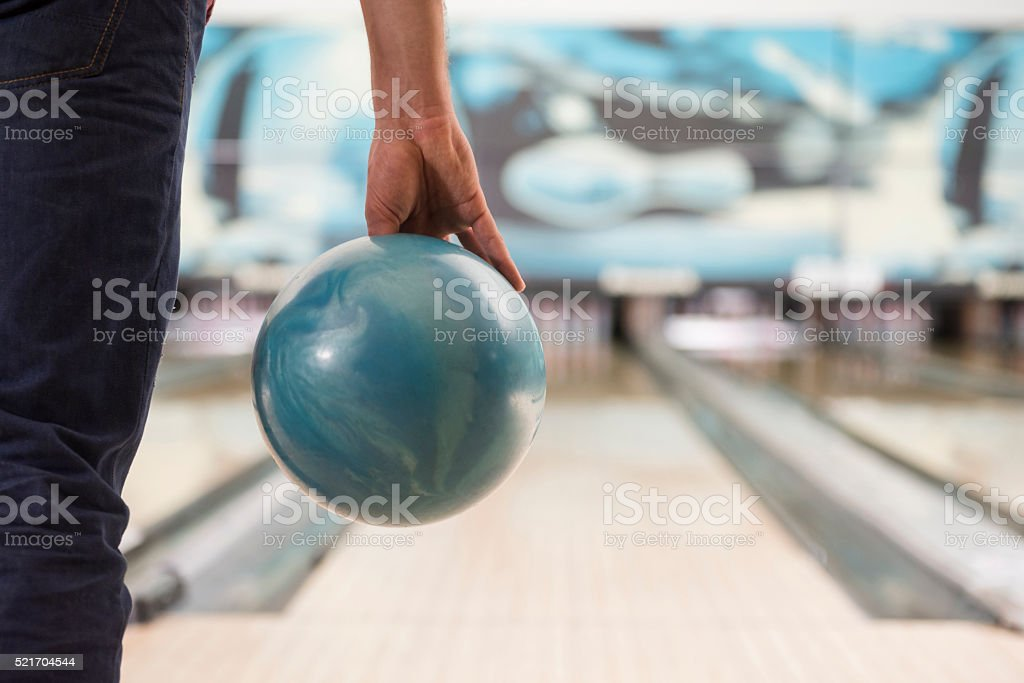 Man about to push the bowling ball stock photo