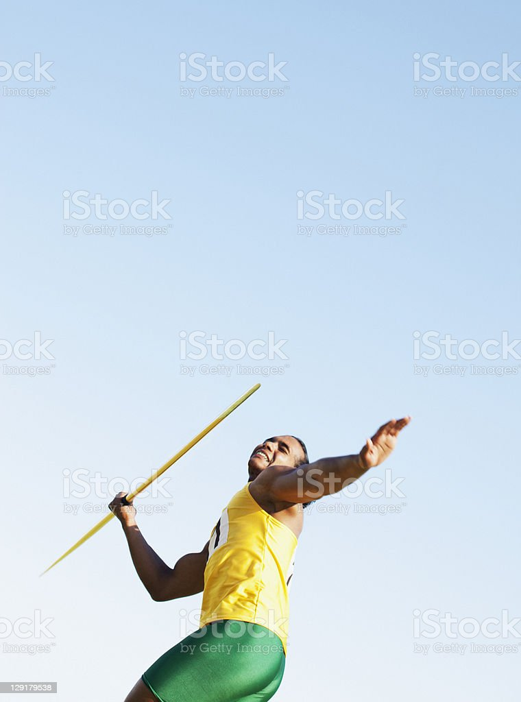 Man about to throw a javelin stock photo