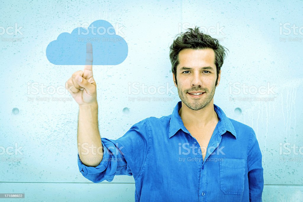 Man accessing cloud computing system stock photo