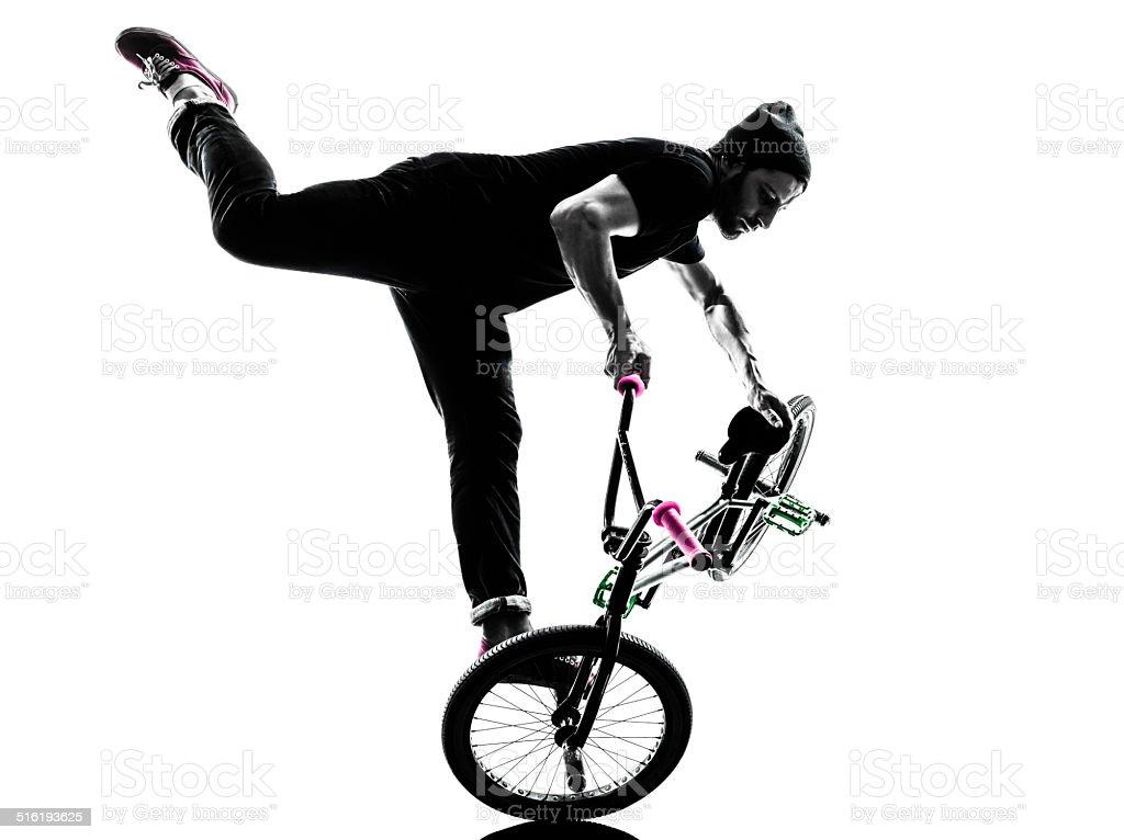 man acrobatic figure silhouette stock photo