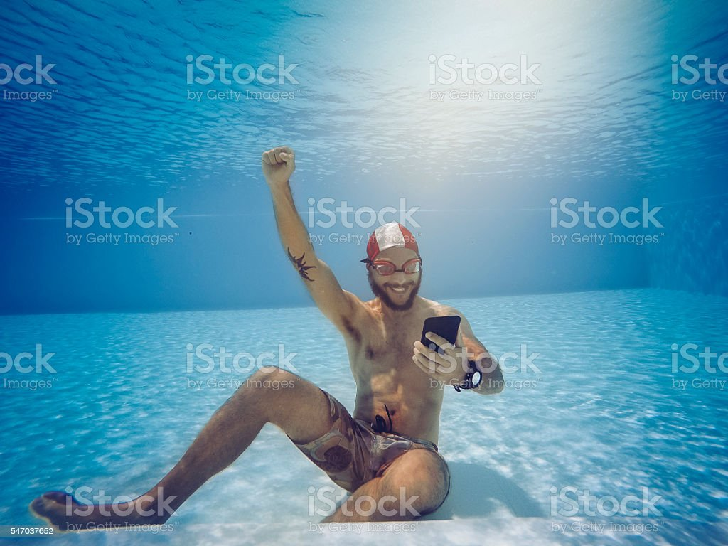 Man addicted to online gambling bets underwater stock photo
