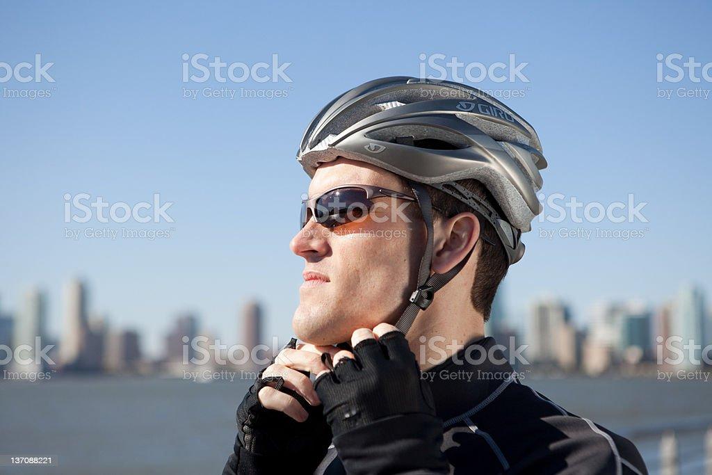 Man adjusting bike helmet strap stock photo