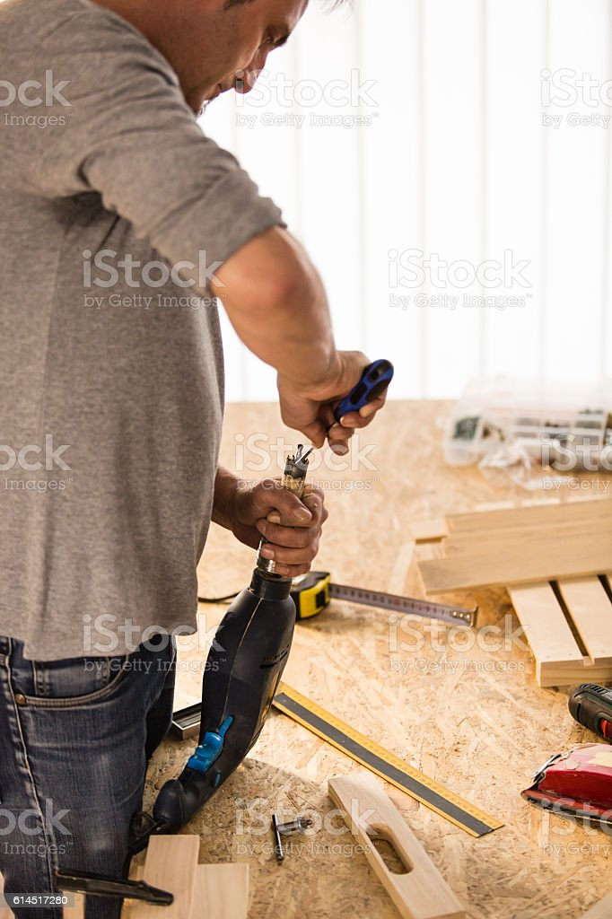 Man adjusting drill bit stock photo