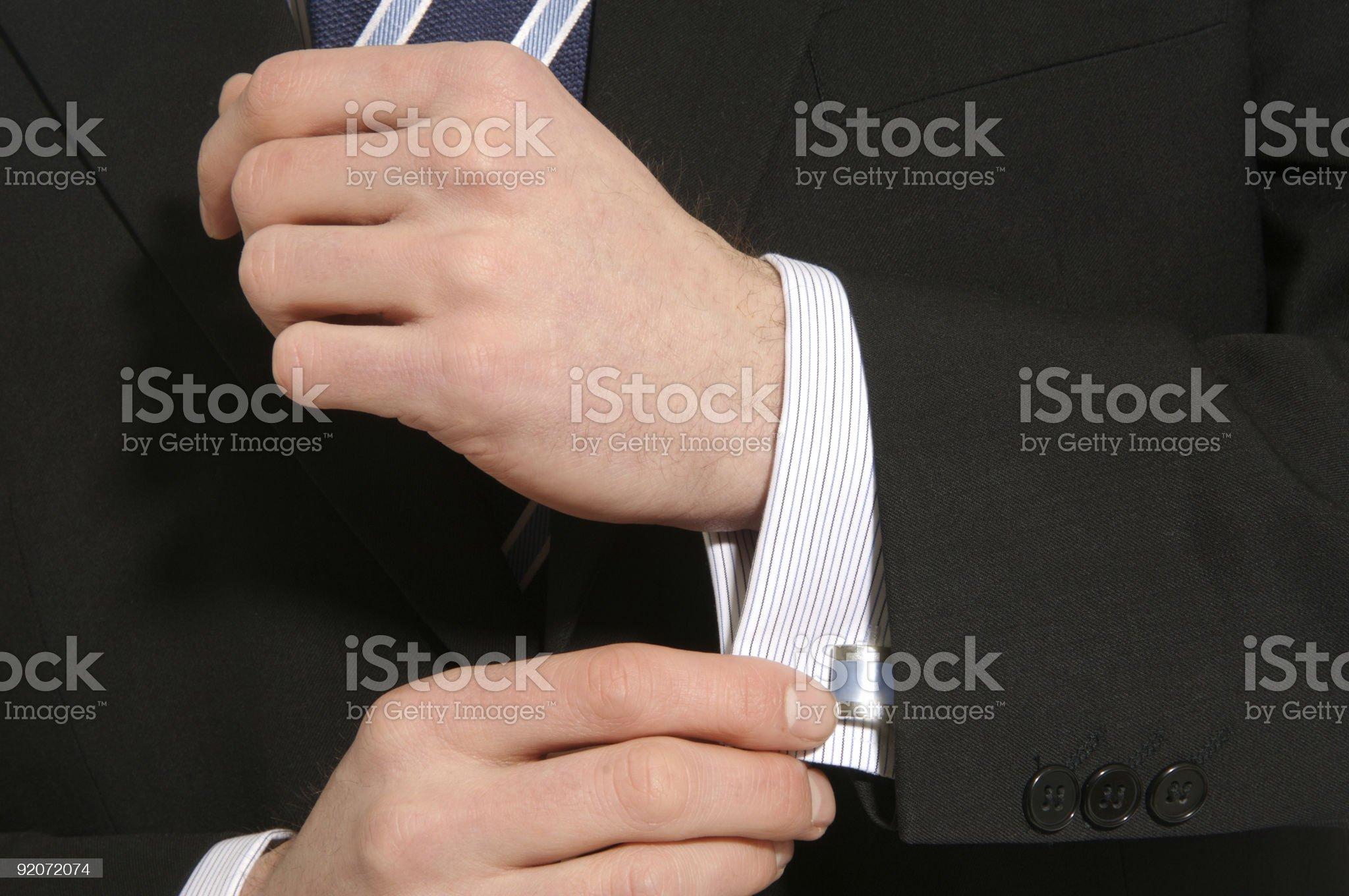 Man adjusting shirt cuff royalty-free stock photo