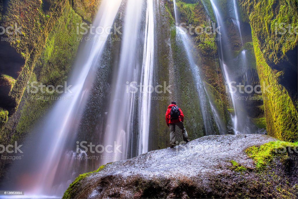 Man admiring Gljúfrafoss waterfall stock photo