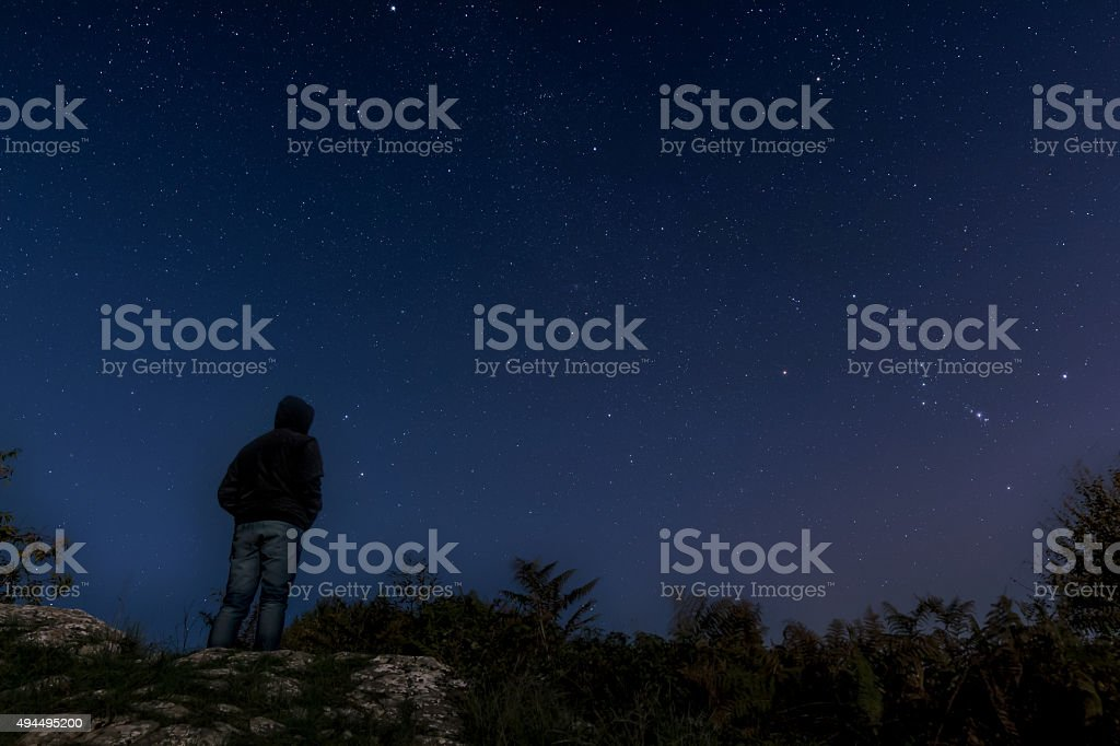 Man admiring the stars stock photo